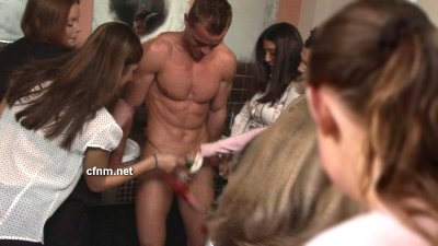 Muscle boy cornered by women in the ladies toilet