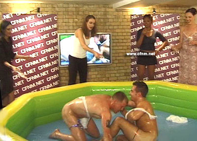 Naked men have to oil wrestle for the entertainment of women